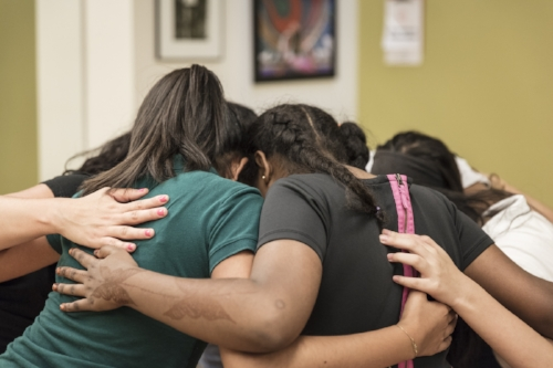 Yoga allows these young women precious moments of self-reflection and the opportunity to build both self confidence and friendship.   Photo:  Courtesy of Girls Inc. of Alameda County
