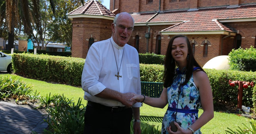 Bishop Bill Wright congratulates Claire McWilliam on winning the Magdalene Award in the Diocese of Maitland-Newcastle for International Women's Day.
