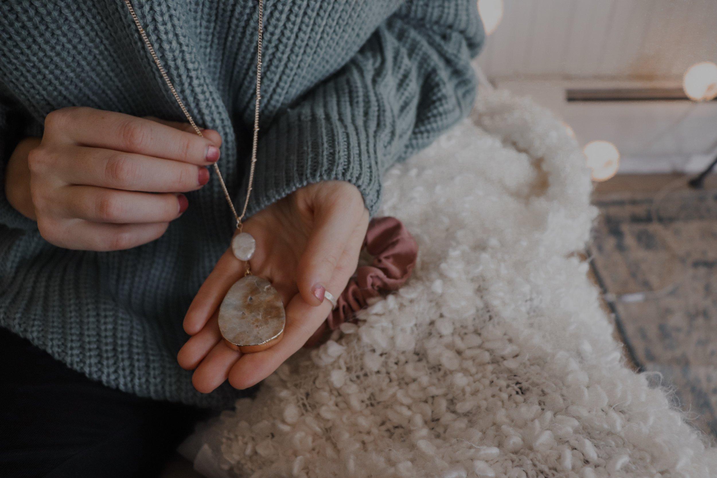 marisataylorjanenecklacesweaterholding