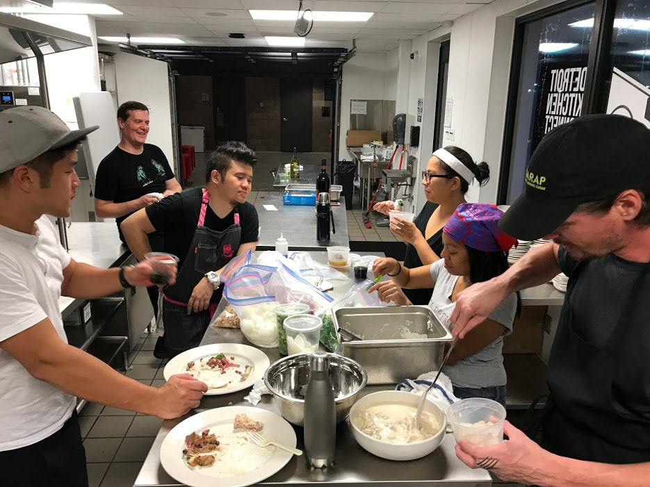 In the kitchen with Sarap Detroit, Detroit, September 2017. The team, with Chef for-hire TJ Robinson (far right) who helped out the Sarap Detroit collab, enjoys a break from prep work with Chef Jon Kung of Eastern Market's  Kung Food  (far left), who brought some tasty snacks.
