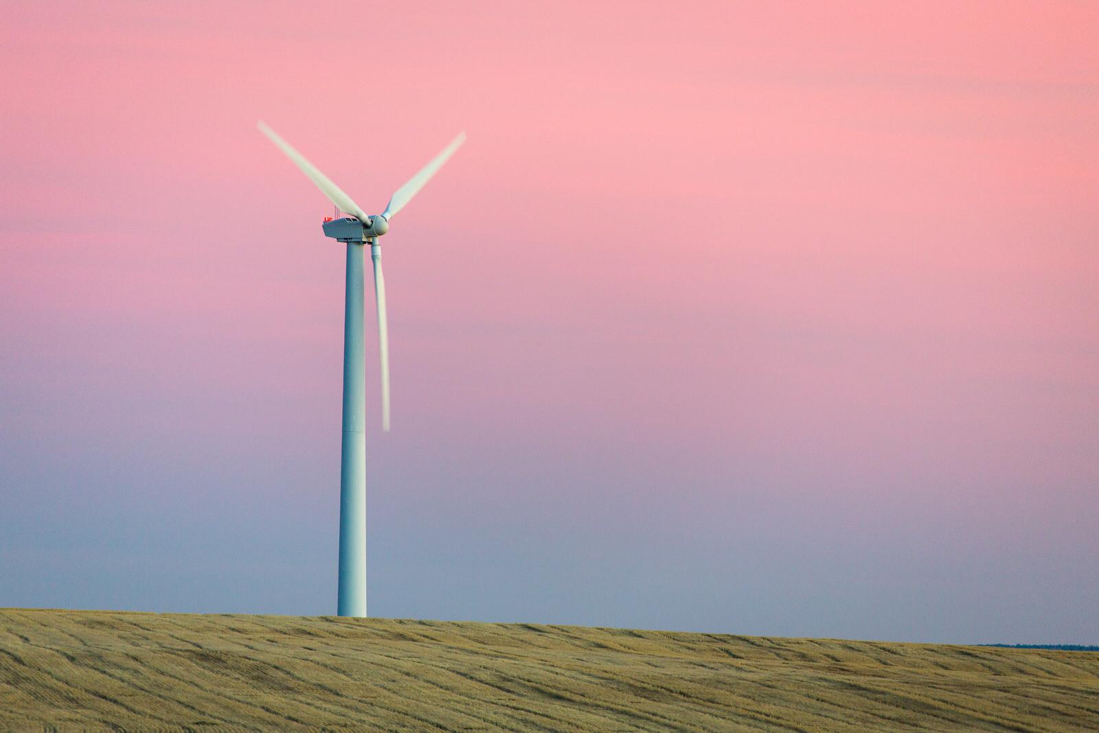 Lone wind turbine in a wheat field at dusk near Wasco, Oregon