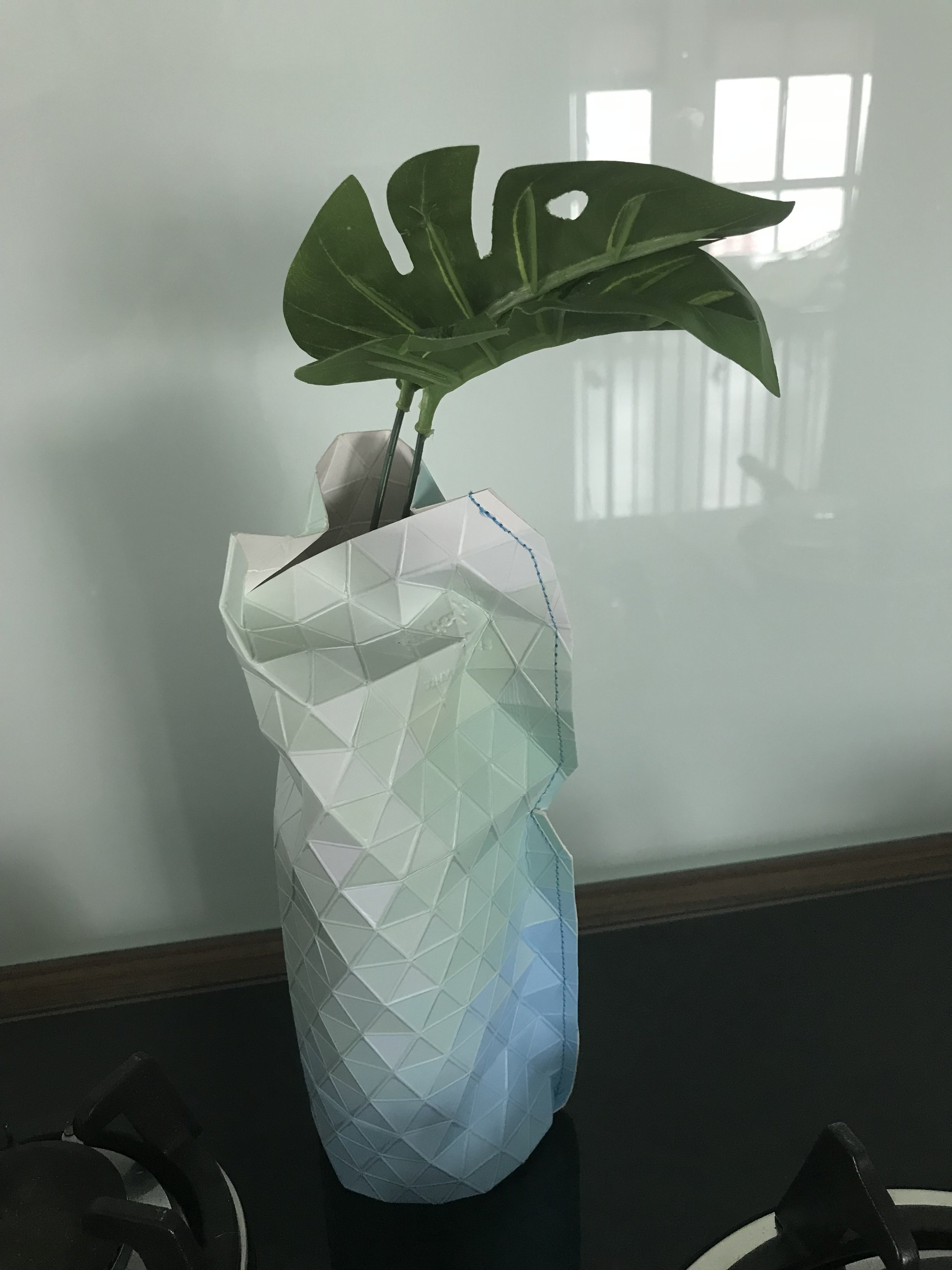 Beer Bottle - Made more aesthetically pleasing using a Paper Vase Cover. Created by women in the Pardeshi community in Mumbai, India, as a part of the Tiny Miracles Foundation, a Netherlands-based charity,