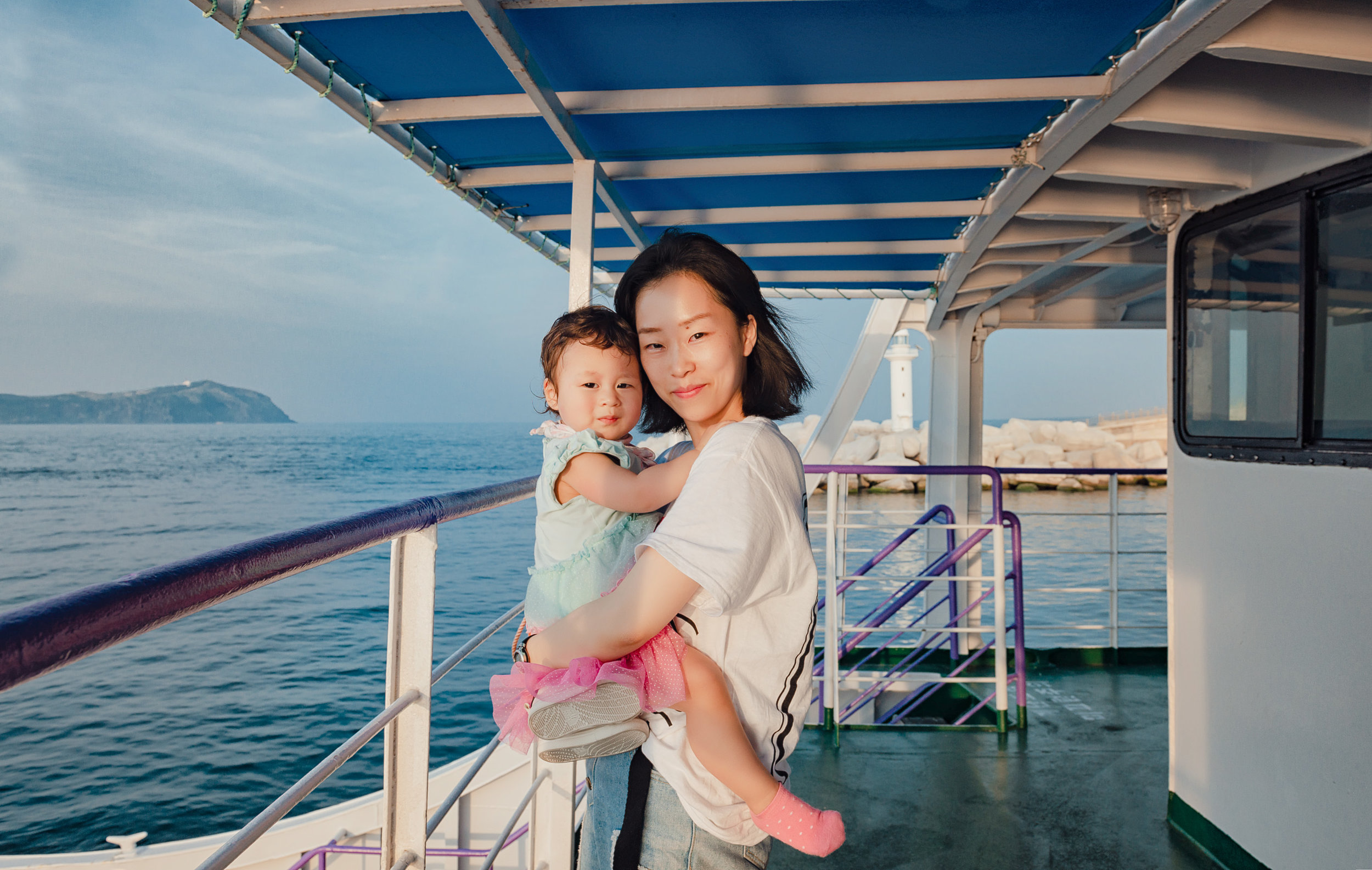 My daughter and wife on a ferry boat from Jeju Island to Udo Island
