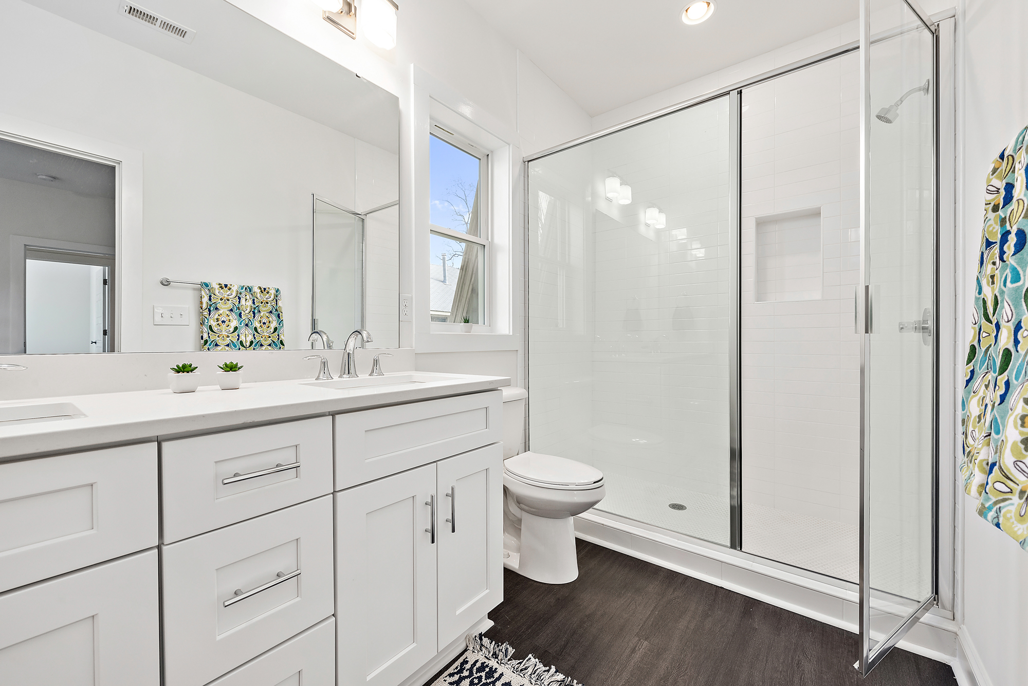 Quartz, Granite & Marble Countertops in Kitchen and Baths. Variety of Tiled backsplashes, Showers & Bathrooms.Semi-Framless or Frameless Glass Shower Door Options. -