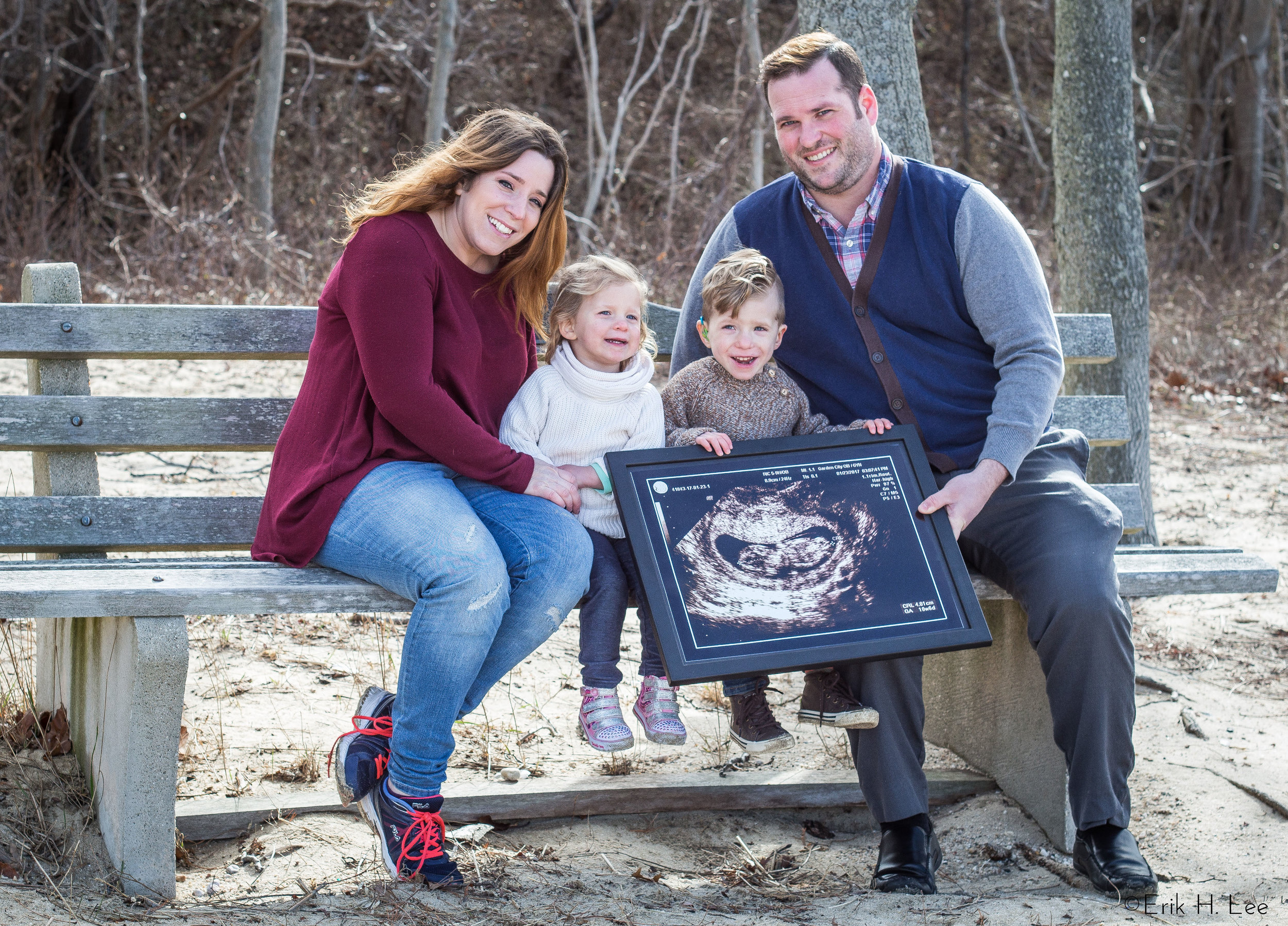 Gianetta Family - Pregnancy Announcement  I am very close with this family. So close in fact that their second child is actually my god-daughter. So it came as no surprise (well maybe to them) when they asked me to photograph something a little unique to announce to the world that baby number three was on the way! We had the idea to take the sonogram and have it blown up big and have the kids hold it up on that really cold February afternoon.