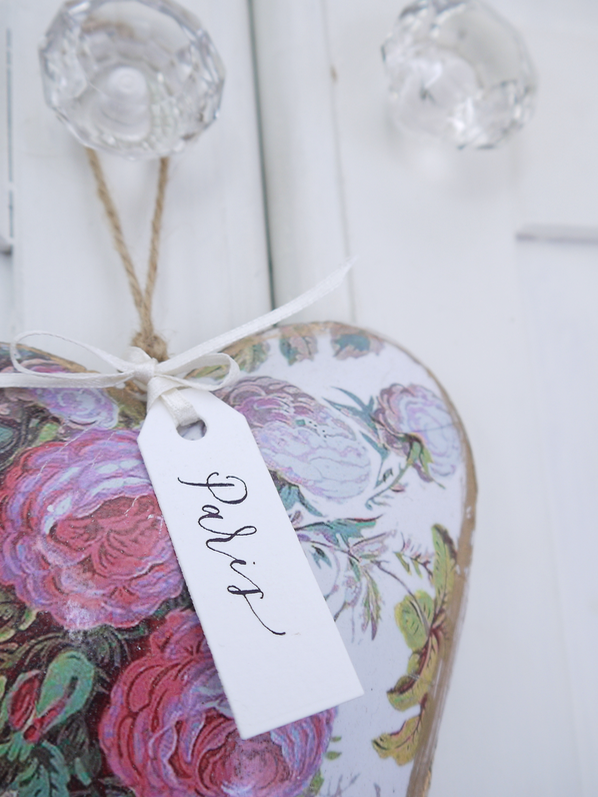 More is more - Just adding a small tag to an existing piece of hanging decor creates another layer of meaning and a reminder of where it came from. Having a place name lettered onto a gift tag can provide a welcome memory of a special holiday or romantic occasion and suggests a story to tell.