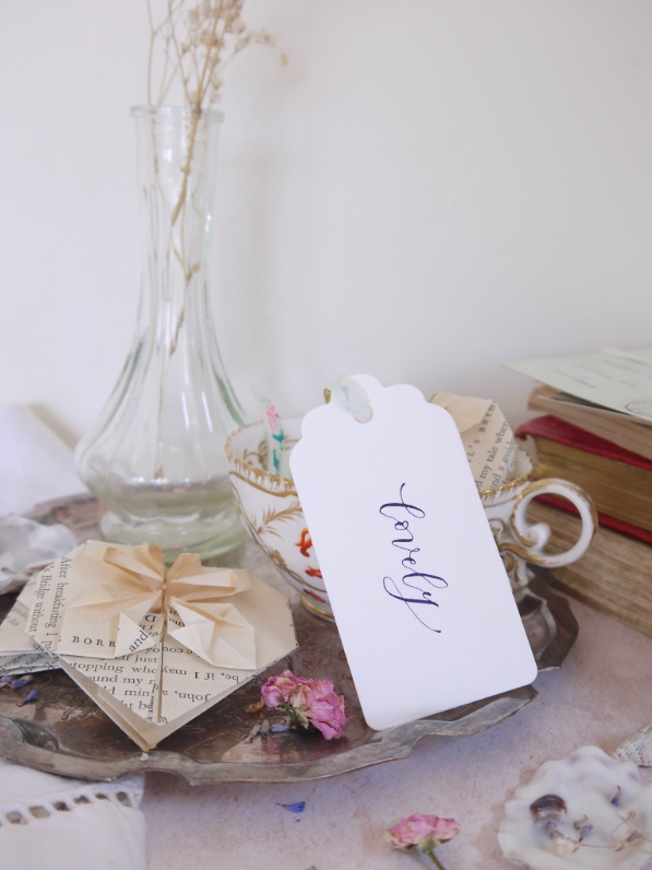 Vignettes & shelves - I don't know about you, but I'm a fan of faffing and making things look pretty. Give me a few vintage objects and foraged finds to arrange and I'm happy - even happier when a there's a calligraphy tag joining in. Style it with your favourite treasures on a shelf or tray on a table to complete the look. I can't resist Victorian tea cups, French glass vases and origami hearts folded from old books.