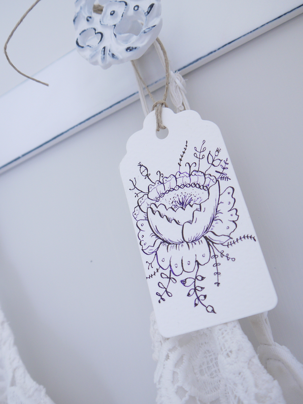Decorating with drawings - It doesn't just have to be lettering that adorns gift tags - delicate drawings work just as well too. Even better in pen and ink. Hang them from empty hooks to add interest and intrigue to a space that could do with some love and attention and voila!