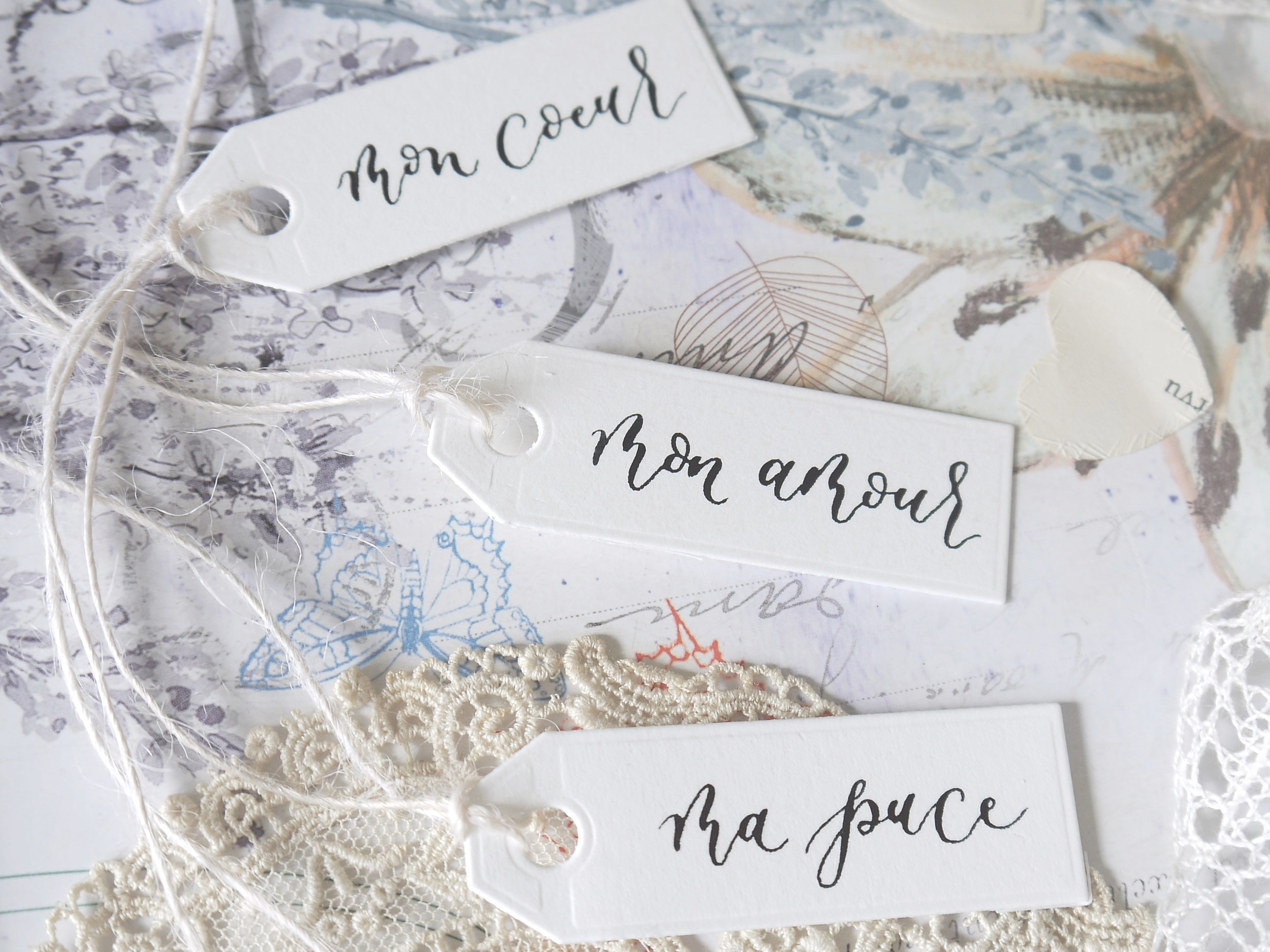 modern calligraphy on gift tags in French