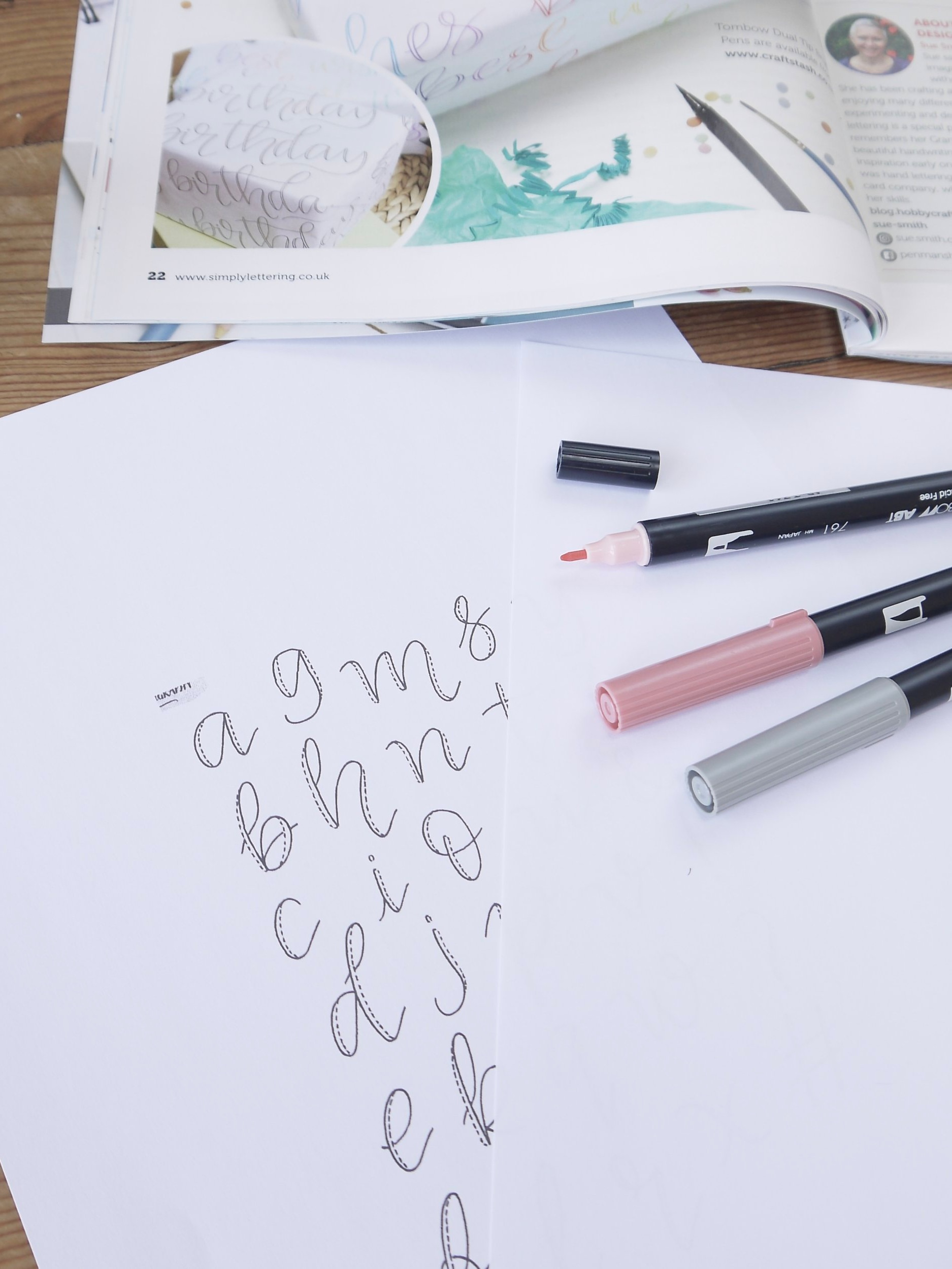 Materials needed for making faux calligraphy wrapping paper, plus a scaled-down version of the alphabet template.