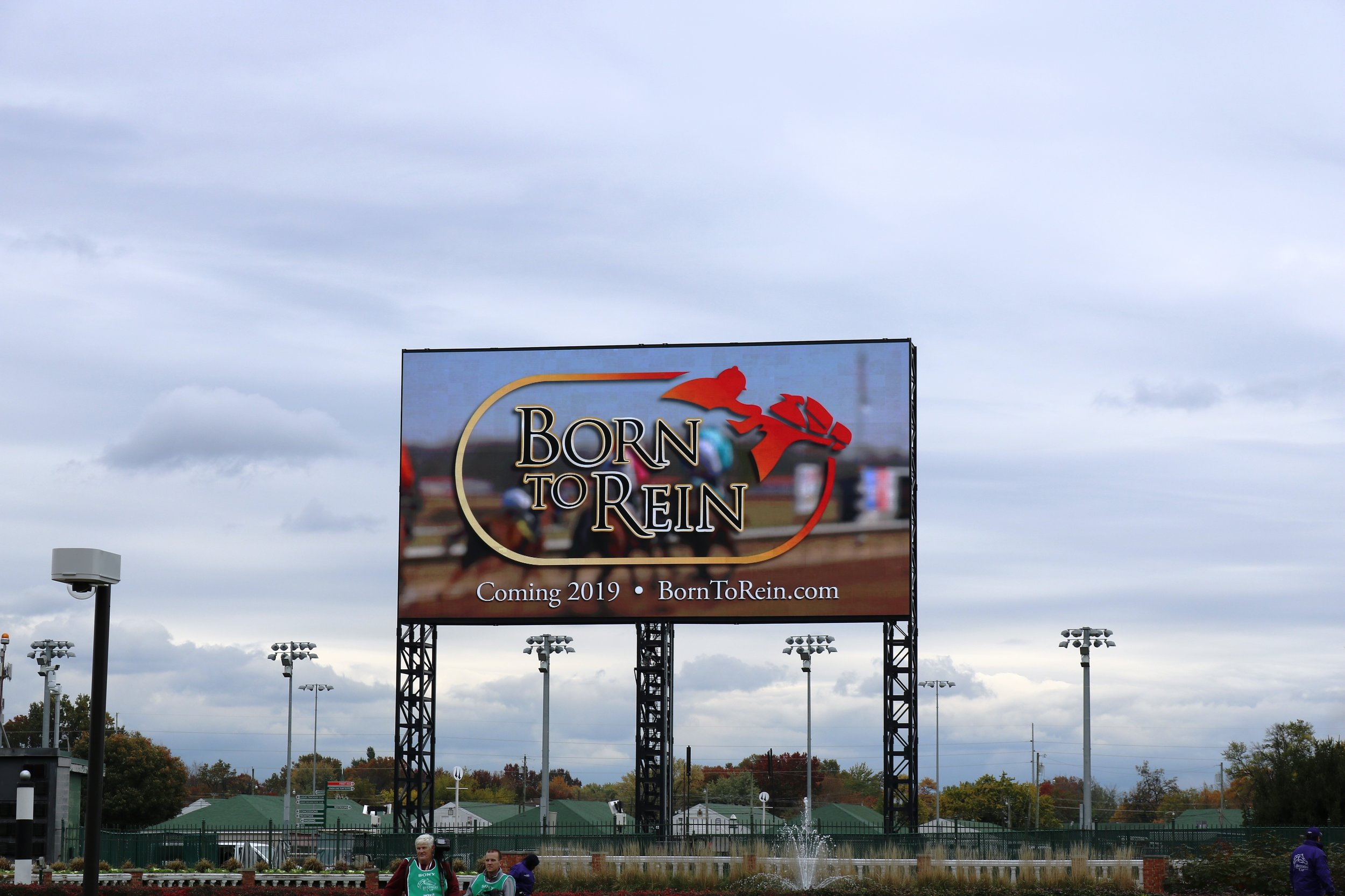 """a :30-second commercial of the upcoming documentary film,   Born To Rein   , was played on Churchill Downs' """"The Big Board"""" – the world's largest 4K video screen in all of sports.  Born To Rein  honors Minatare, Nebraska native, John A. Nerud -- who was instrumental in co-founding the Breeders' Cup and served as its inaugural marketing committee chairman -- along with fellow Nebraskans, father-and-son trainers, Marion and Jack Van Berg of Columbus."""
