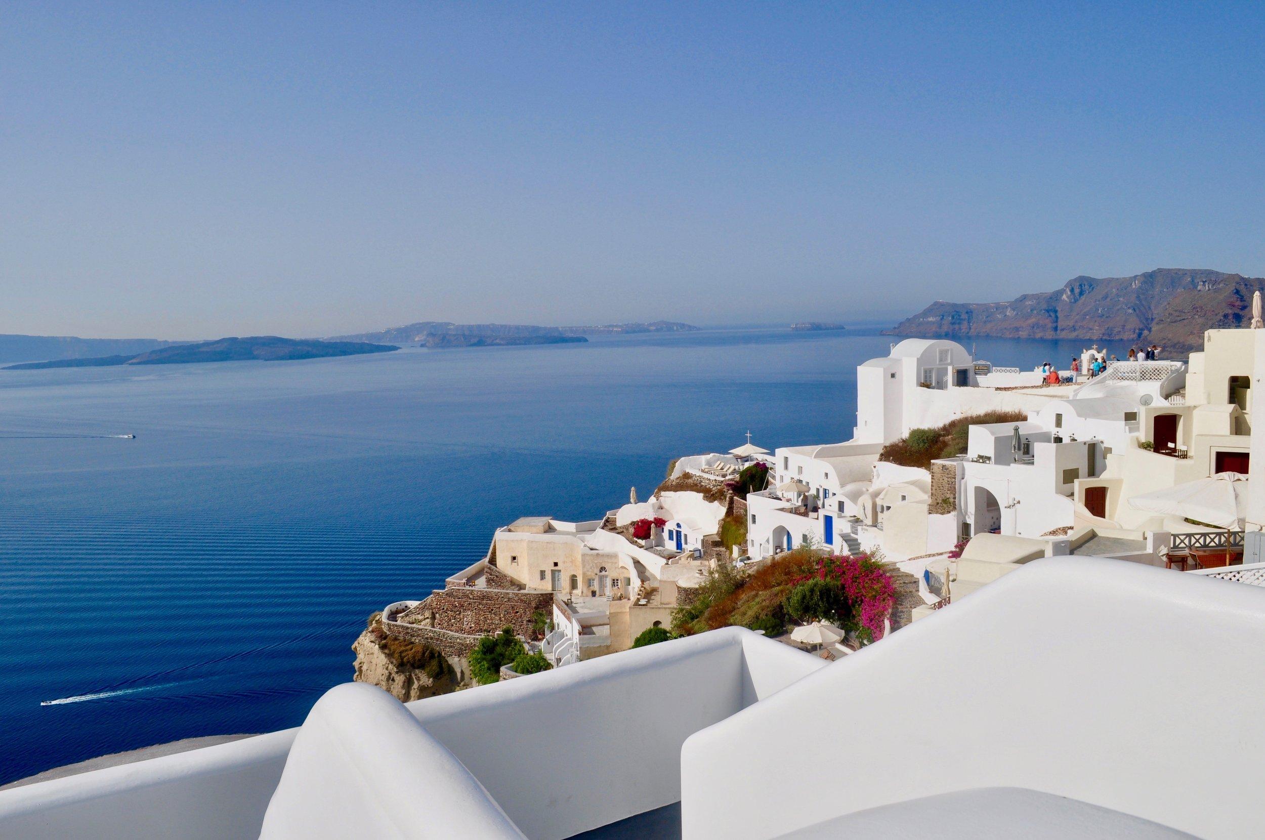 Exploring the Greek Isles on a Cruise - A Happy Passport #greece #santorini #oia #cruise