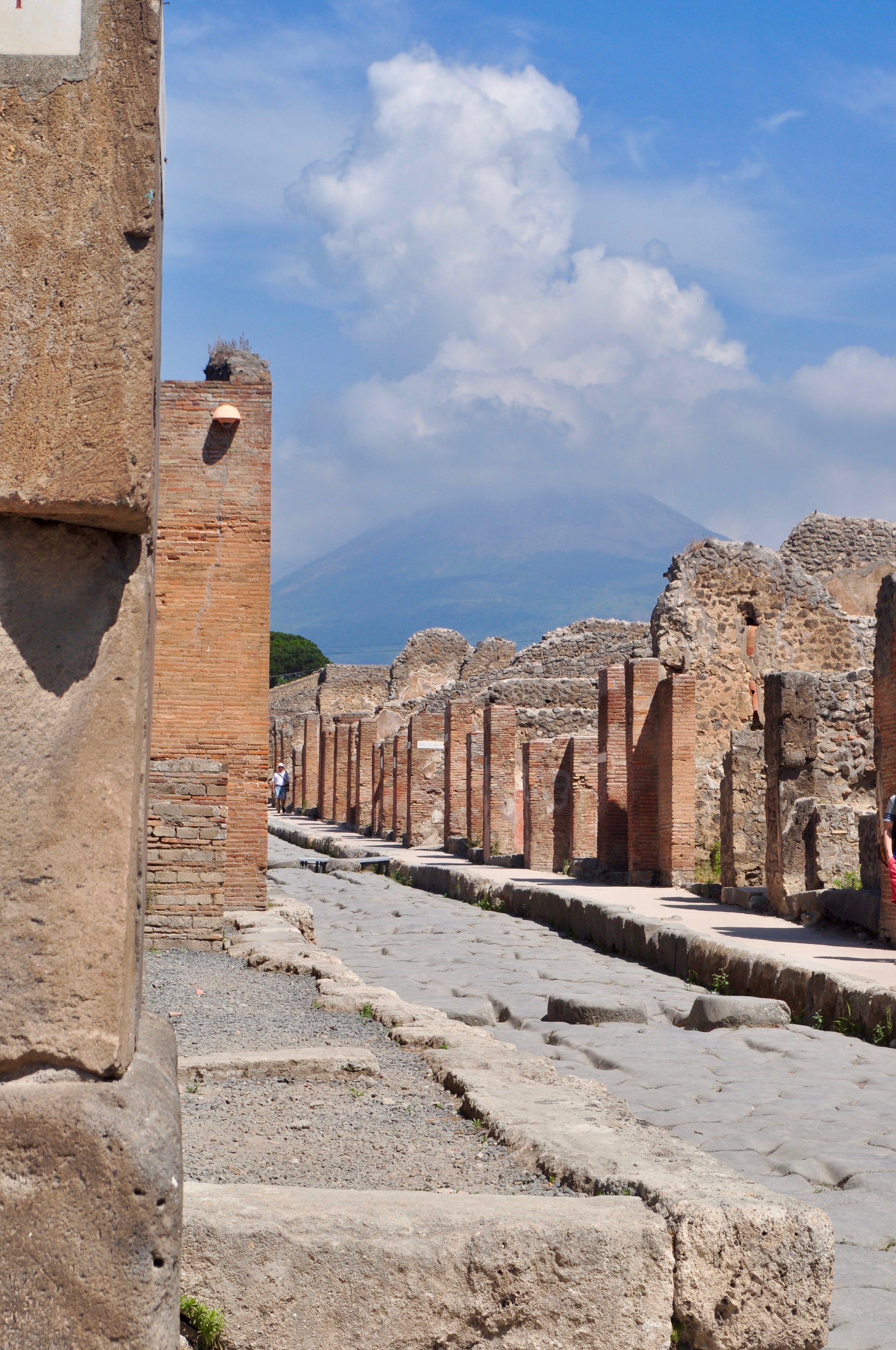 Streets of Pompeii with the deadly Mount Vesuvius in the background