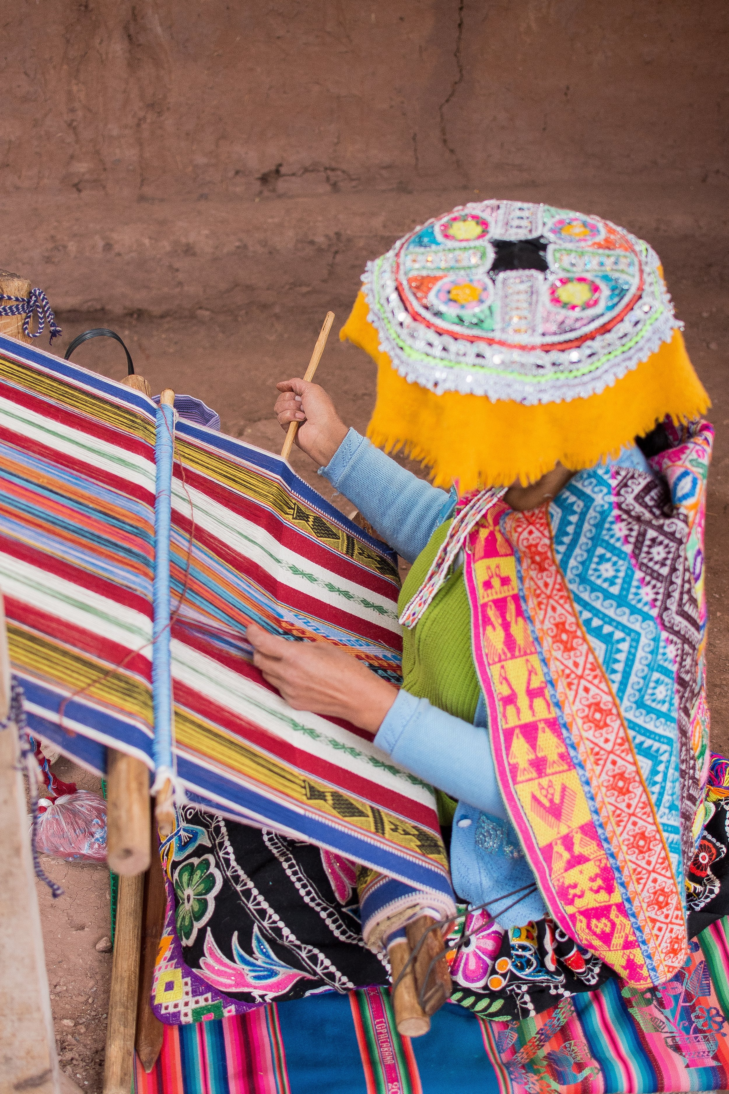 Woman weaving a baby Alpaca blanket