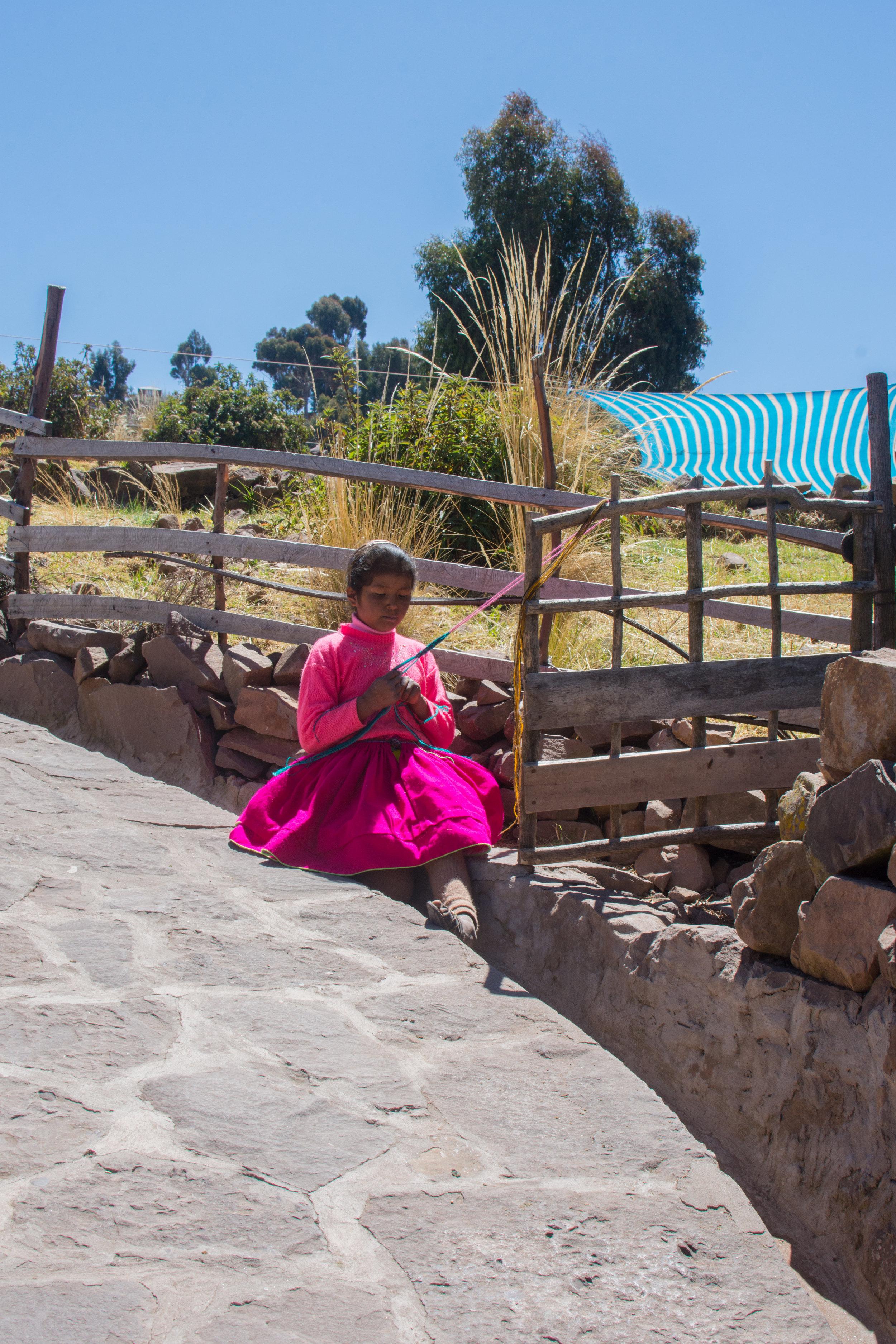 Young Girl Weaving Yarn
