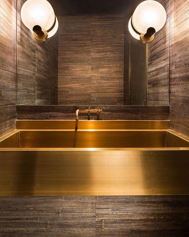 Gilded farm style sink in this penthouse powder bathroom.  #interiordesign #interiors #interiordecor #penthouse #luxury #residentialdesign #farmstyledecor #design #powder #powderbath #inspiration #wallpapers #designinspo #designinspiration