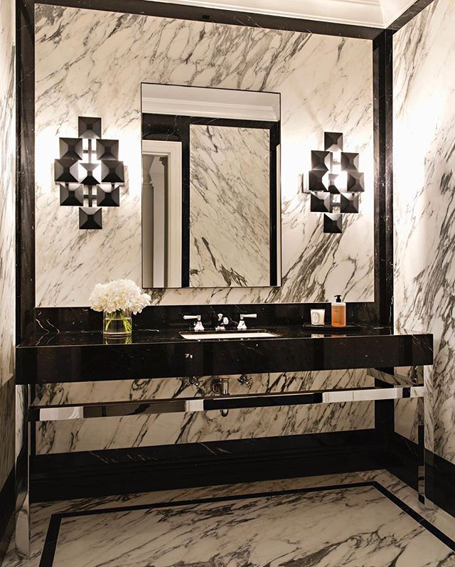 Gorgeous marble-covered powder bathroom for one of our favorite projects in Holmby Hills.  #interiordesign #interiors #luxuryinteriors #luxury #residentialdesign #design #interiordecor #holmbyhills