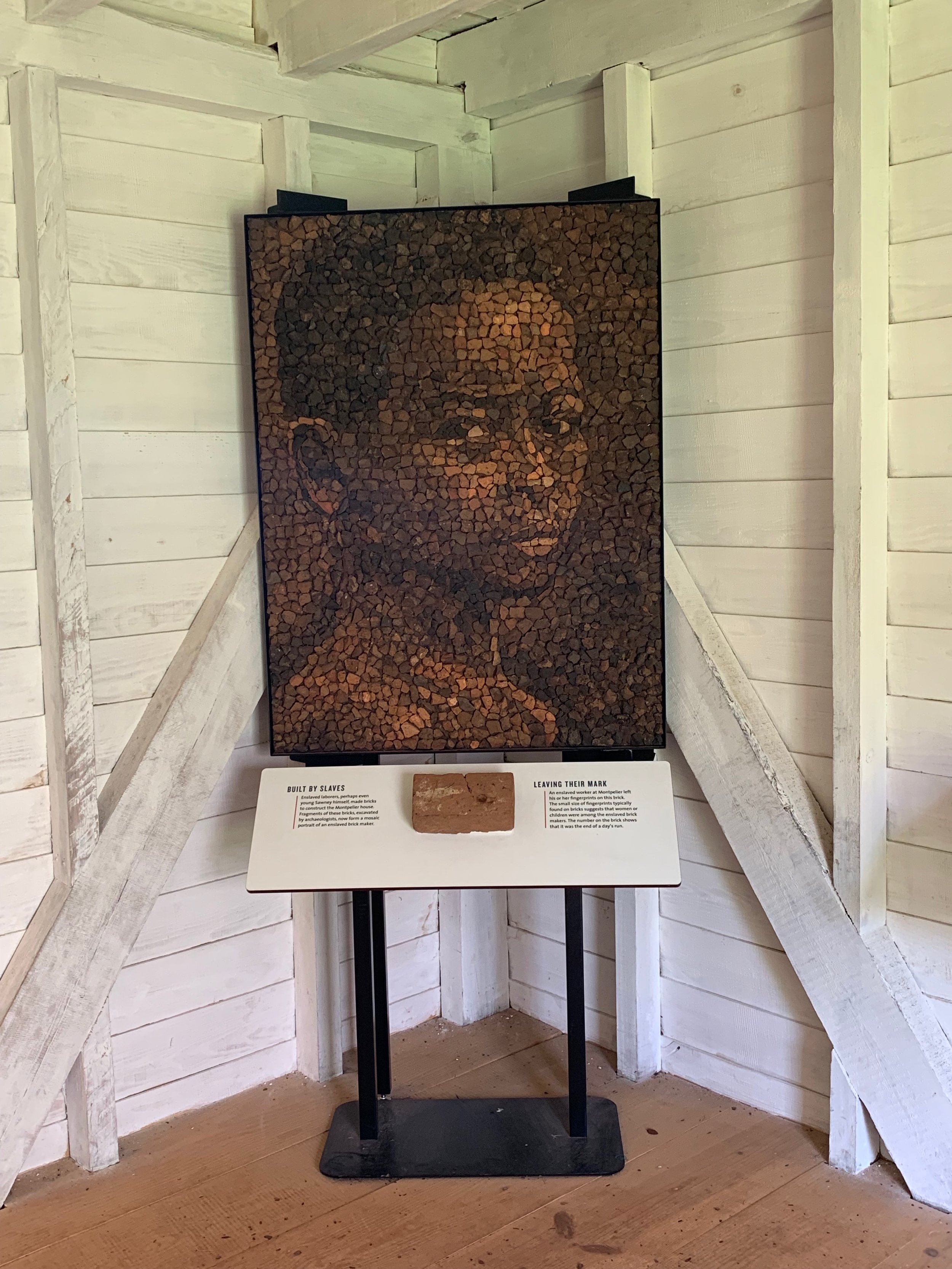 Brick mosaic of young enslaved boy constructed out of brick pieces excavated from the South Yard. Some of the shards contained fingerprints of the brick makers. Created by  Proun Design , The Montpelier Foundation. Photo by Renée Ater, August 2019.