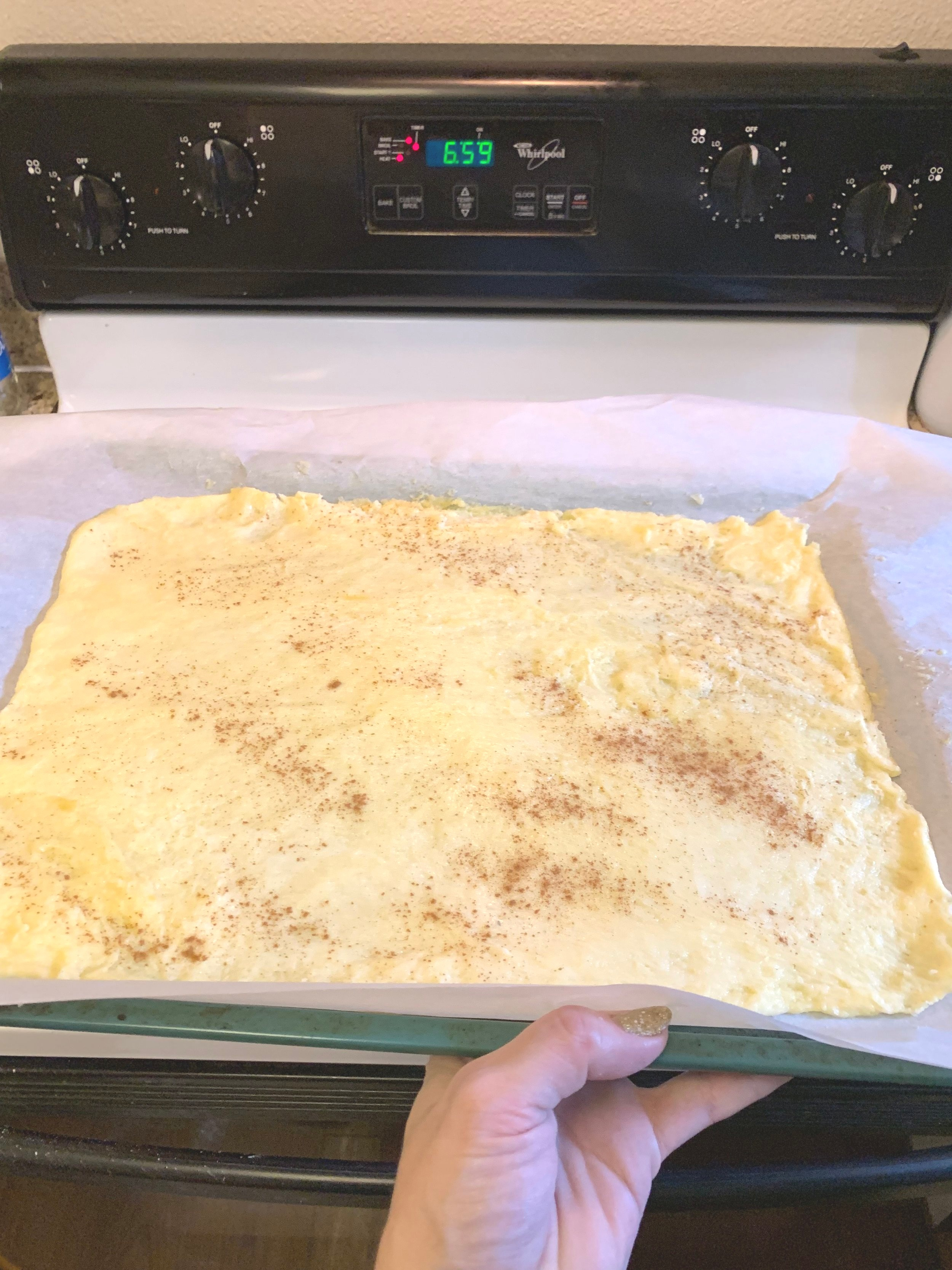3. Roll out into a rectangle on parchment paper and sprinkle cinnamon on top. Bake for 7 min at 350 degrees. This will help it set and make it easier to roll-up. -