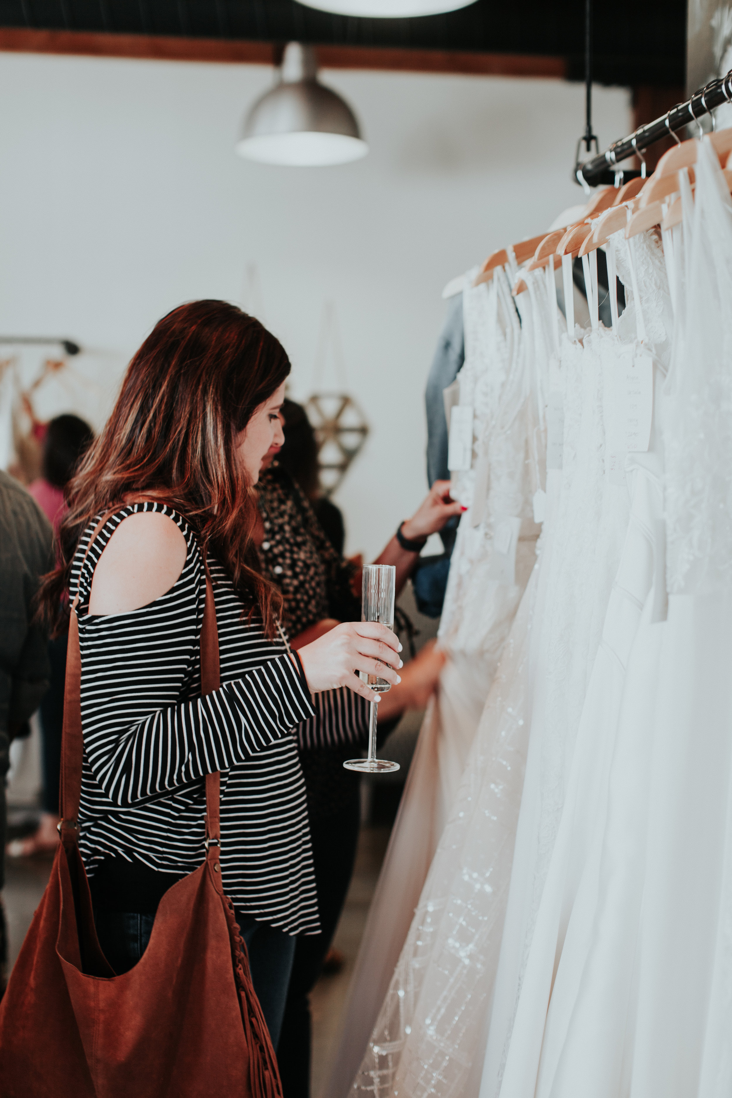5. Inspect the Gown - The samples have been tried on by previous brides and some dresses will have a bit of wear and tear. Before you commit, look over the dress for any damages and be aware that alterations are not done in-house (however, we do have great local recommendations).Photo credit: Alexandra Wallace