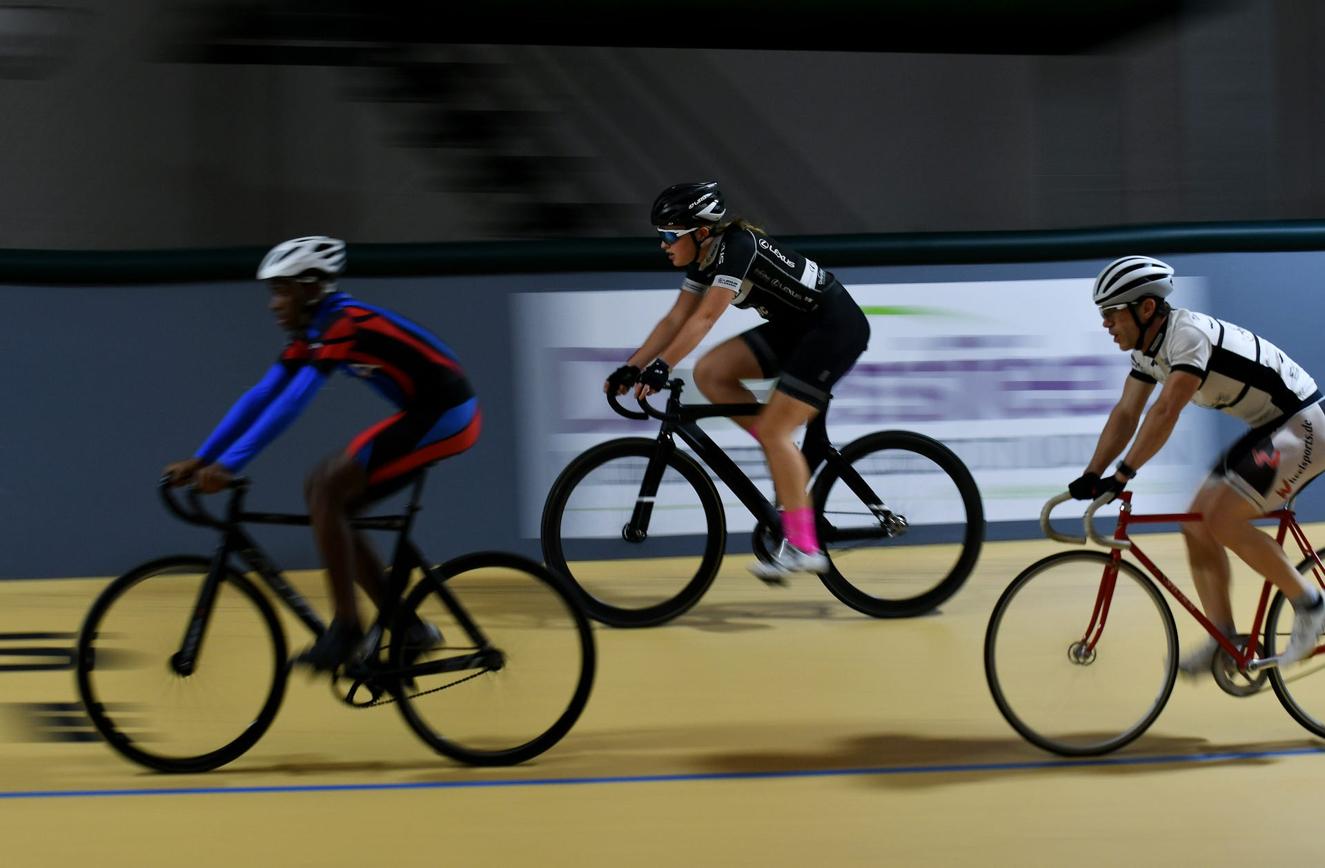 Donell Anderson, left, 12, of Detroit, Autumn Caya, 15, of Shelby Township and Charles Moore, 45, of Plymouth ride warm up laps. Robin Buckson, The Detroit News