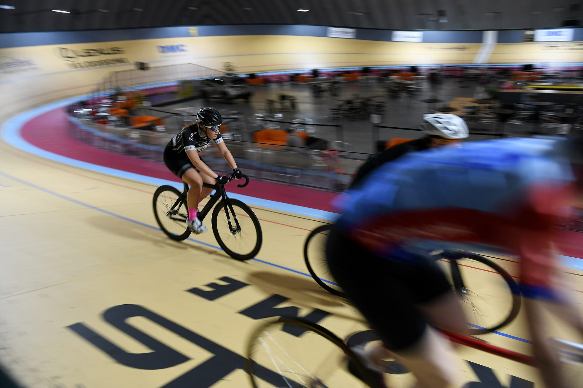 Autumn Caya, 15, of Shelby Township, left, rides warm up laps at the Thursday night structured training at the Lexus Velodrome in Detroit on June 13, 2019. Caya is one of the youth going to the National Track Championship in California.Robin Buckson, The Detroit News