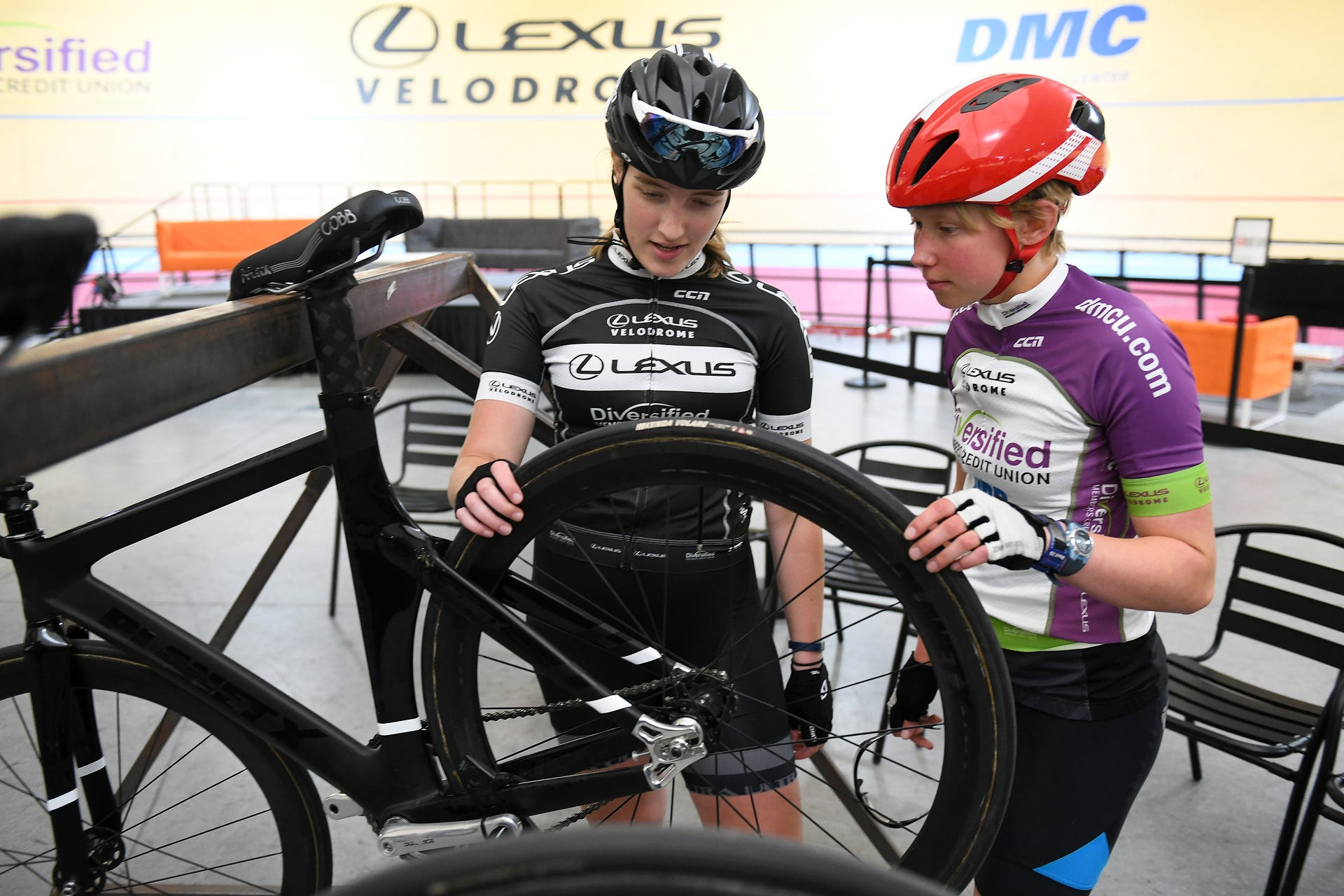 Rebecca Hartrick, 16, of Auburn Hills, right, with Autumn Caya, 15, of Shelby Township talking about bicycle tires at the Thursday night structured training at the Lexus Velodrome in Detroit on June 13, 2019. (Robin Buckson / The Detroit News)Robin Buckson, The Detroit News
