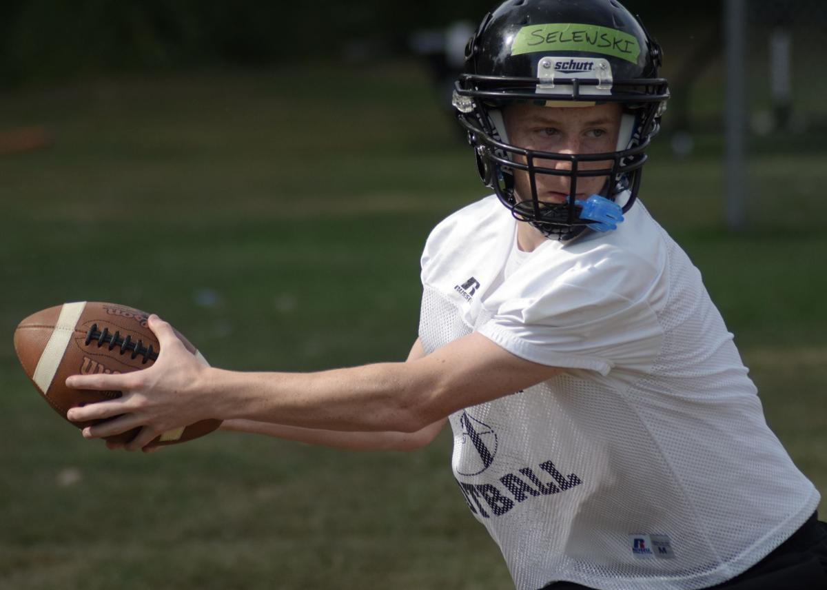 Zach Selewski runs through a drill during Lutheran North practice.