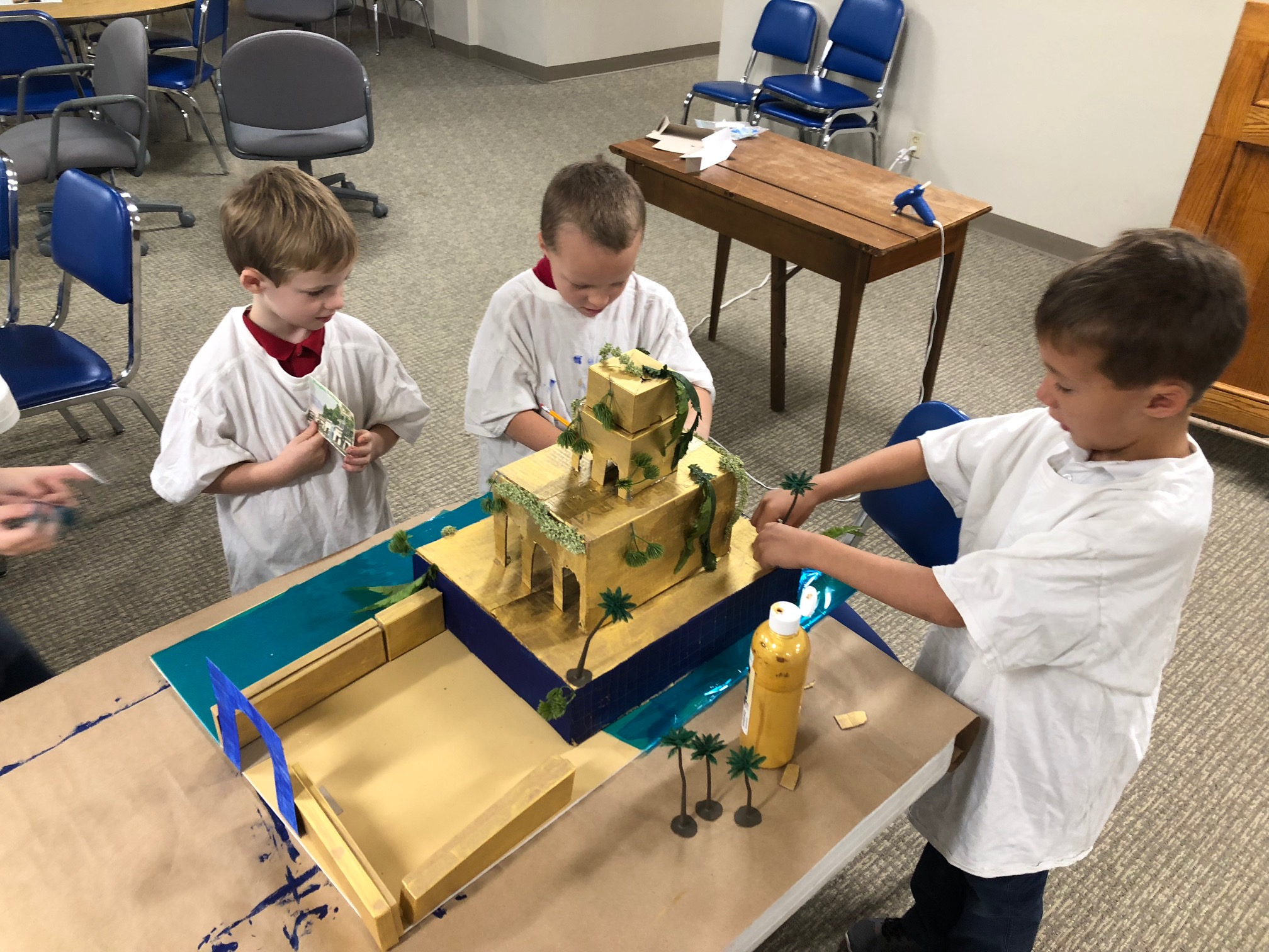 Students work together to create a diorama of the Hanging Gardens of Babylon in art class. The curriculum at STCA works in cycle, so children encounter one era -Aancient, Medieval, or Modern - across disciplines and ages.