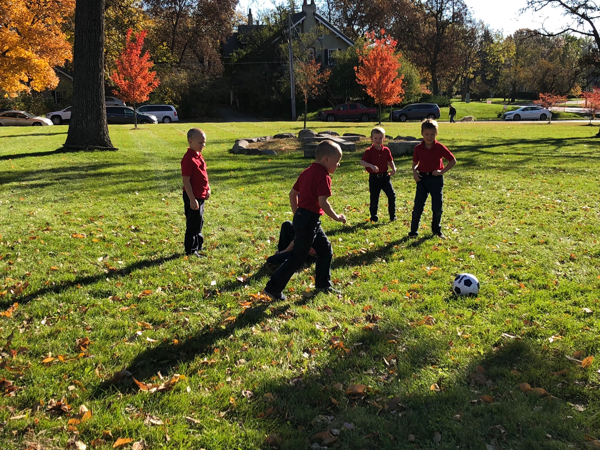 Children playing soccer at recess. STCA has nearly 2 hours of breaks for the children during the school day so that the children have time to exercise and enjoy the outdoors.