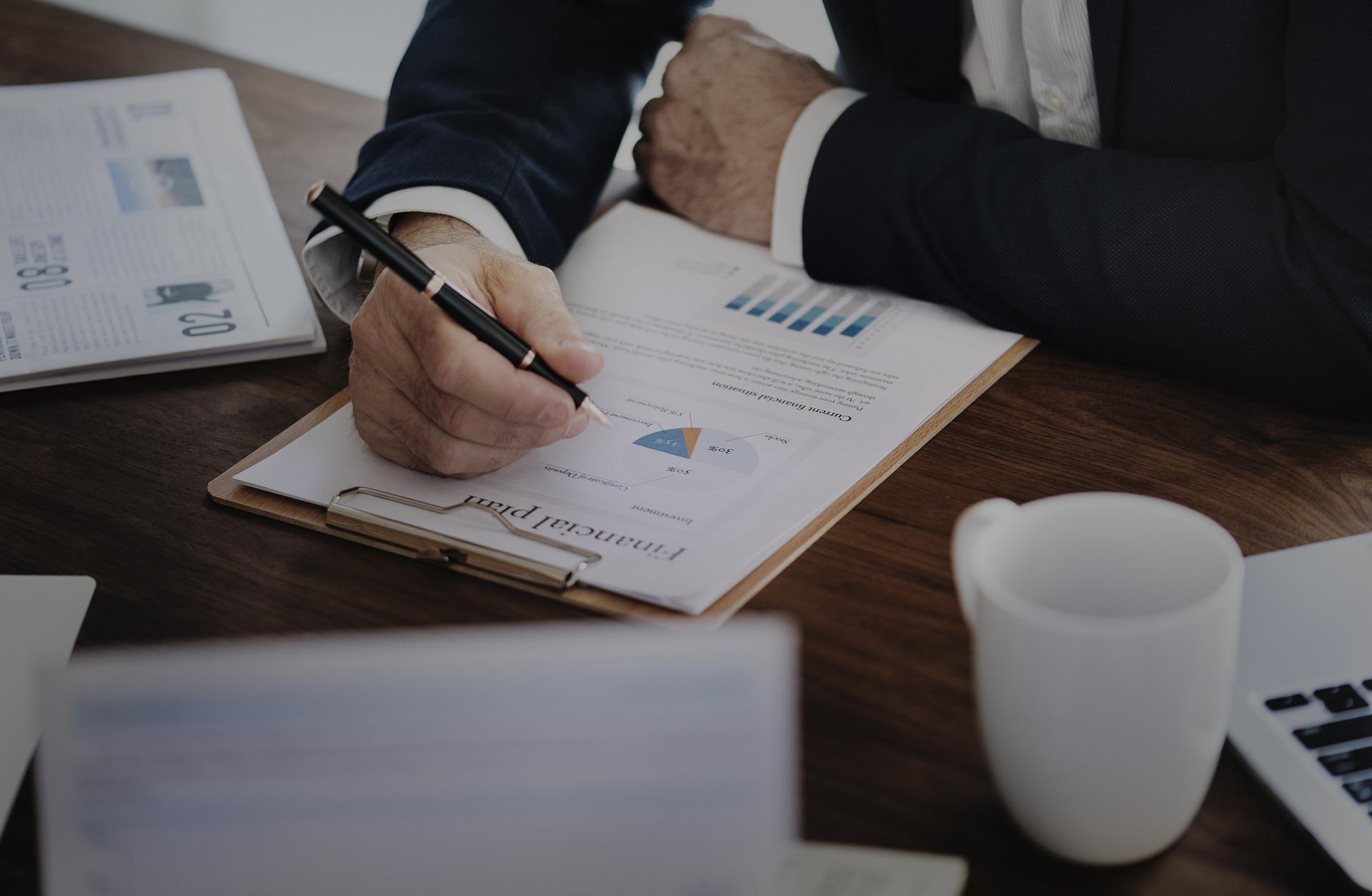 CIO writing on financial charts