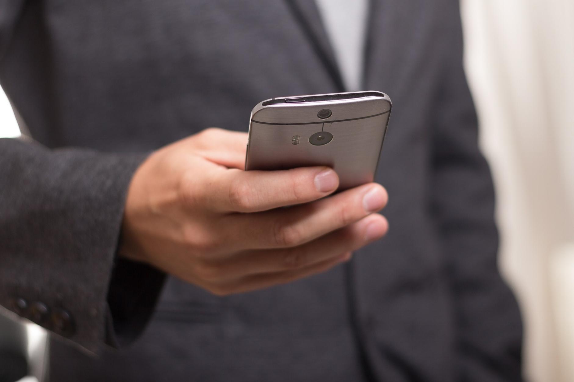 CIO with cellphone