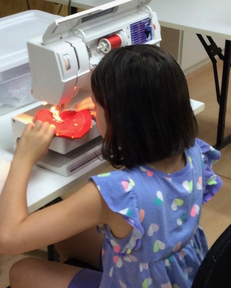 Learning to sew at Fun Camp