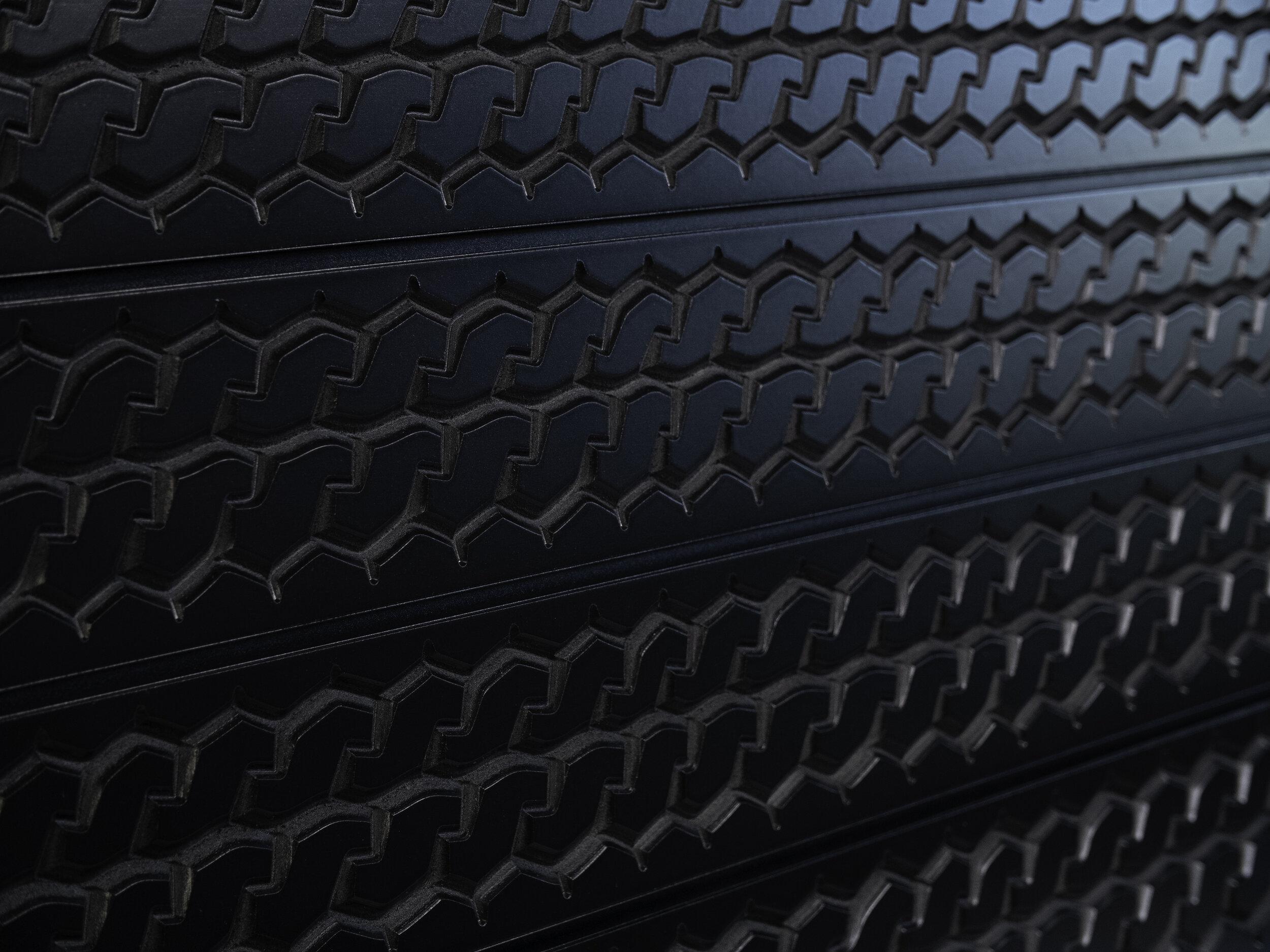 STX tire tread black angle shot.jpg