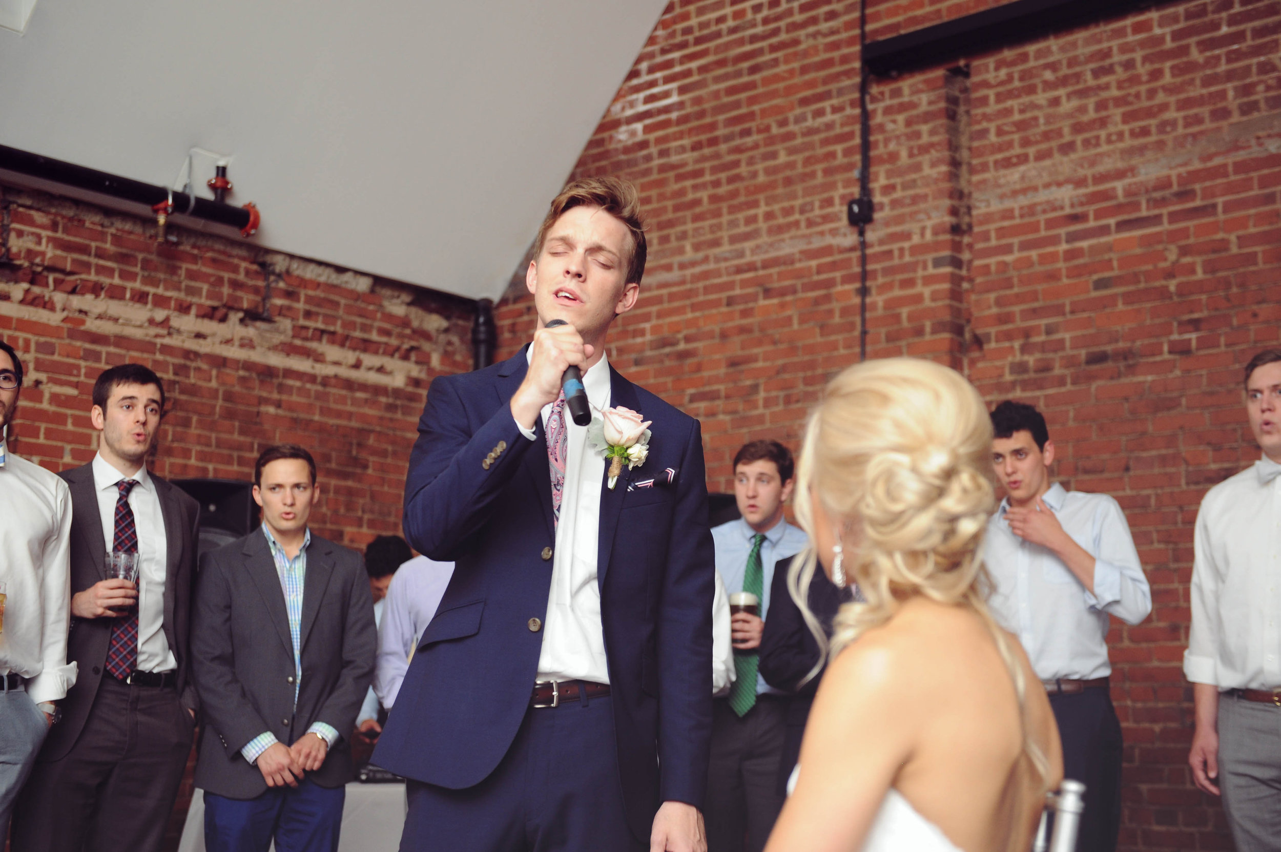 Singing to his bride.jpg
