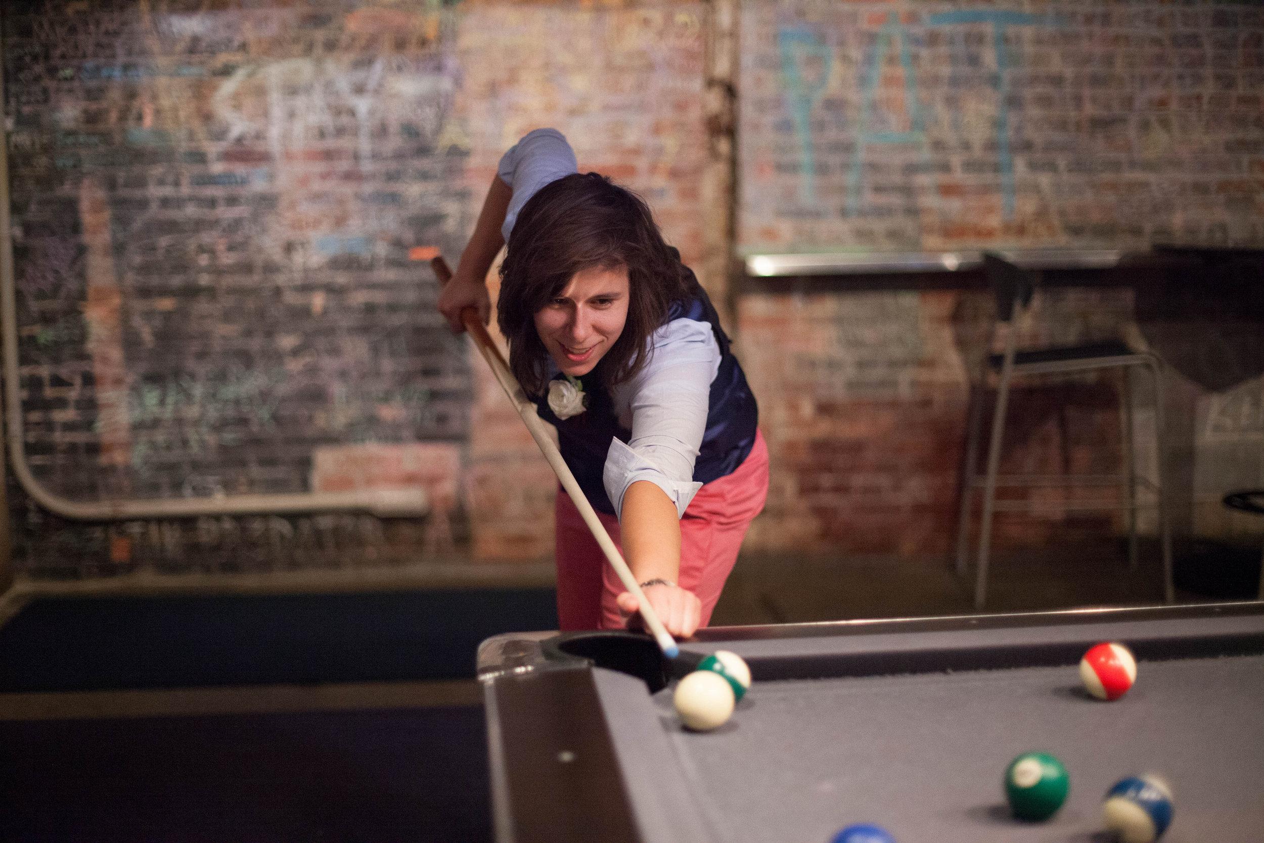 Great-Room_bride-playing-pool.jpg
