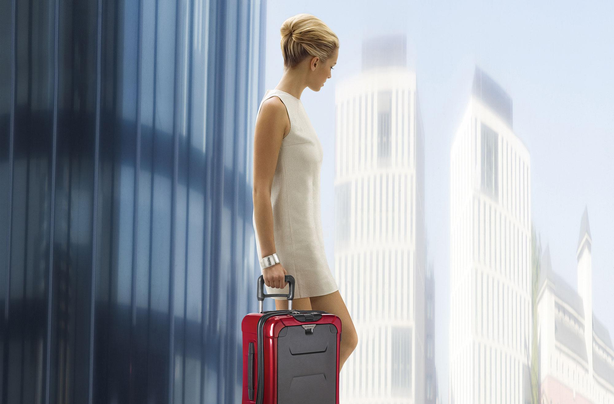 GirlCover_holding_torq_luggage1.jpg