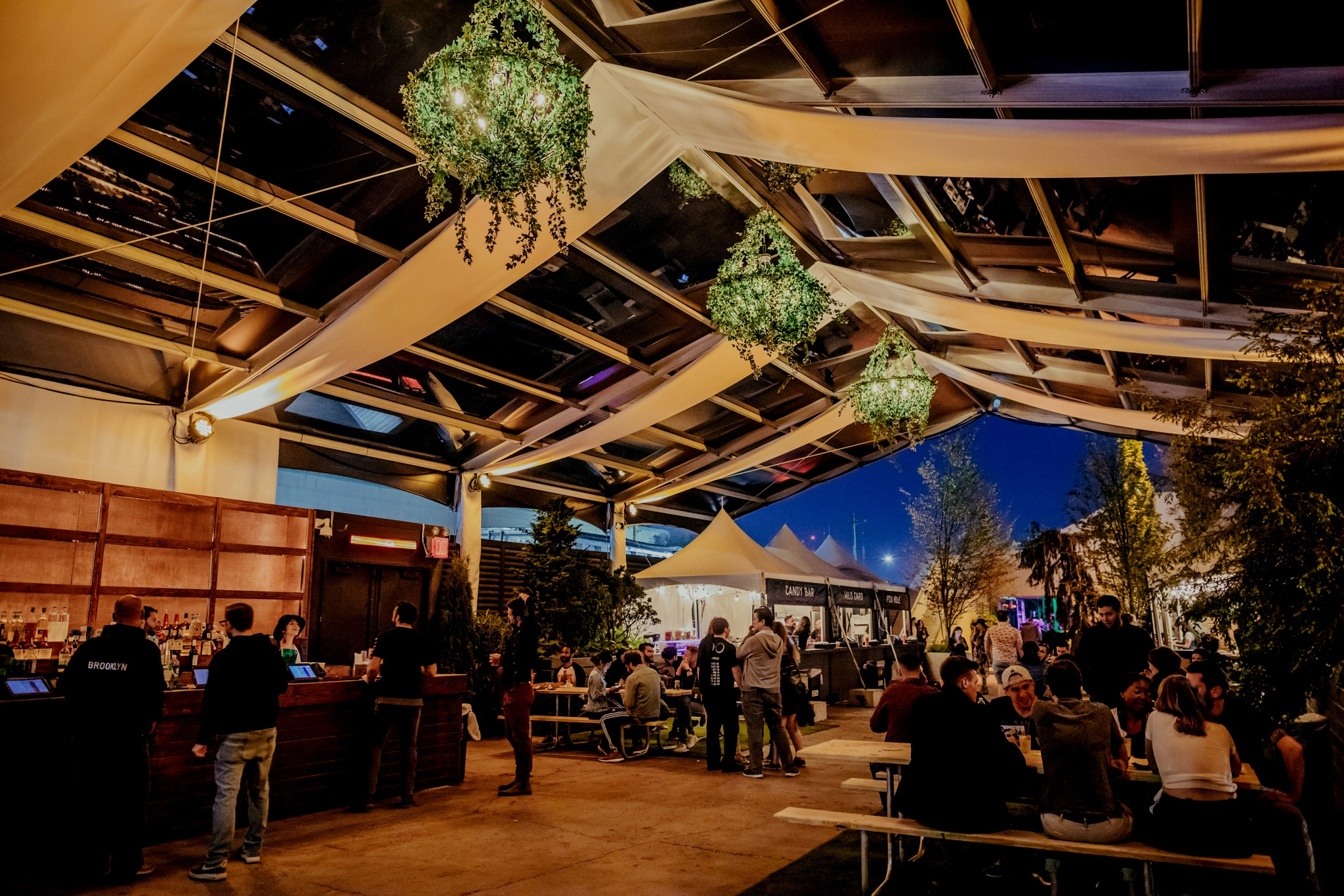 GARDEN LOUNGE & FOOD COURT - The latest addition to the Brooklyn Mirage is a sheltered Food Court with a full-range of octo-lacto-vegan-friendly options from Pizza, Tacos, Tapas as well as a Candy Bar, with boozy Milkshakes, ice cream and more. Come early for sunset dining and drinking!!