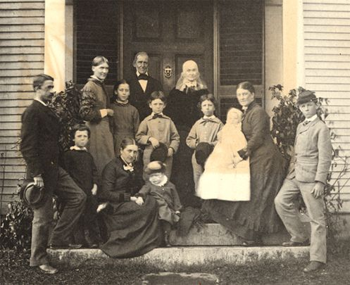 The Emersons in 1879 with their children and grandchildren on the East Doorstep, Emerson House. Standing left to right; Edward Emerson, Edward Forbes, Ellen Emerson, Edith Forbes, Ralph Waldo Emerson, Cameron Forbes, Lidian Emerson, Don Forbes, Ralph Forbes. Seated left to right; Annie Keyes Emerson, Charles Emerson, Edith Emerson Forbes holding Waldo Forbes.