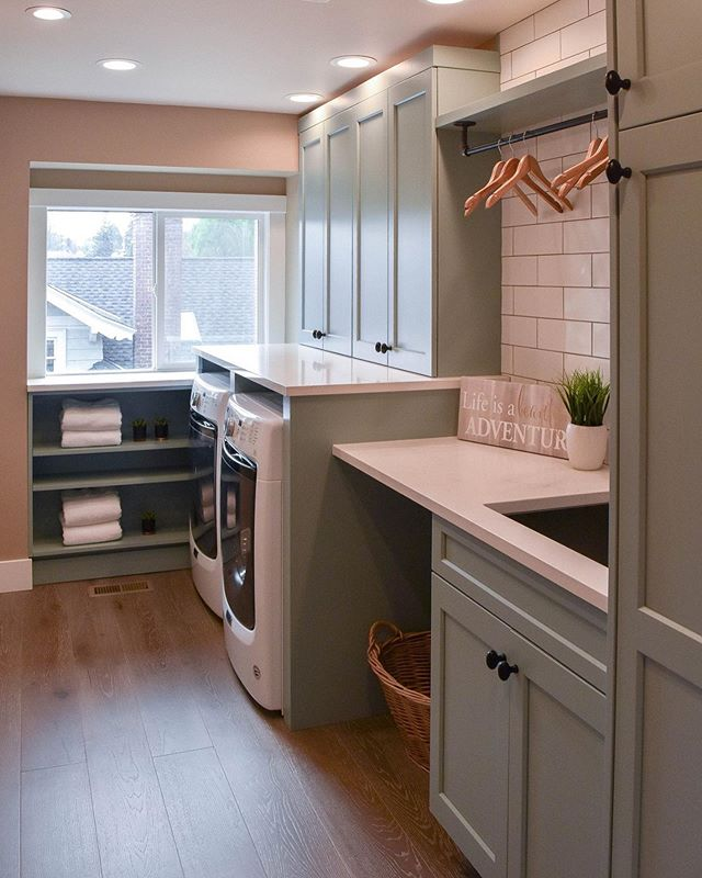 Who wouldn't mind doing laundry in this cute space? Check out the before & after!