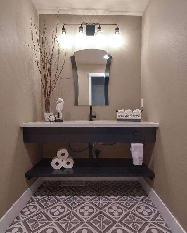 We are huge fans of small spaces that make a statement. Just like this powder bath with it's deco tile floor and beautiful vanity space! (swipe for more photos + before)