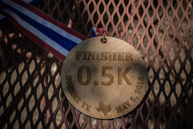 The hard-earned wooden medals each finisher received. Photo Credit:Lanell Mantey
