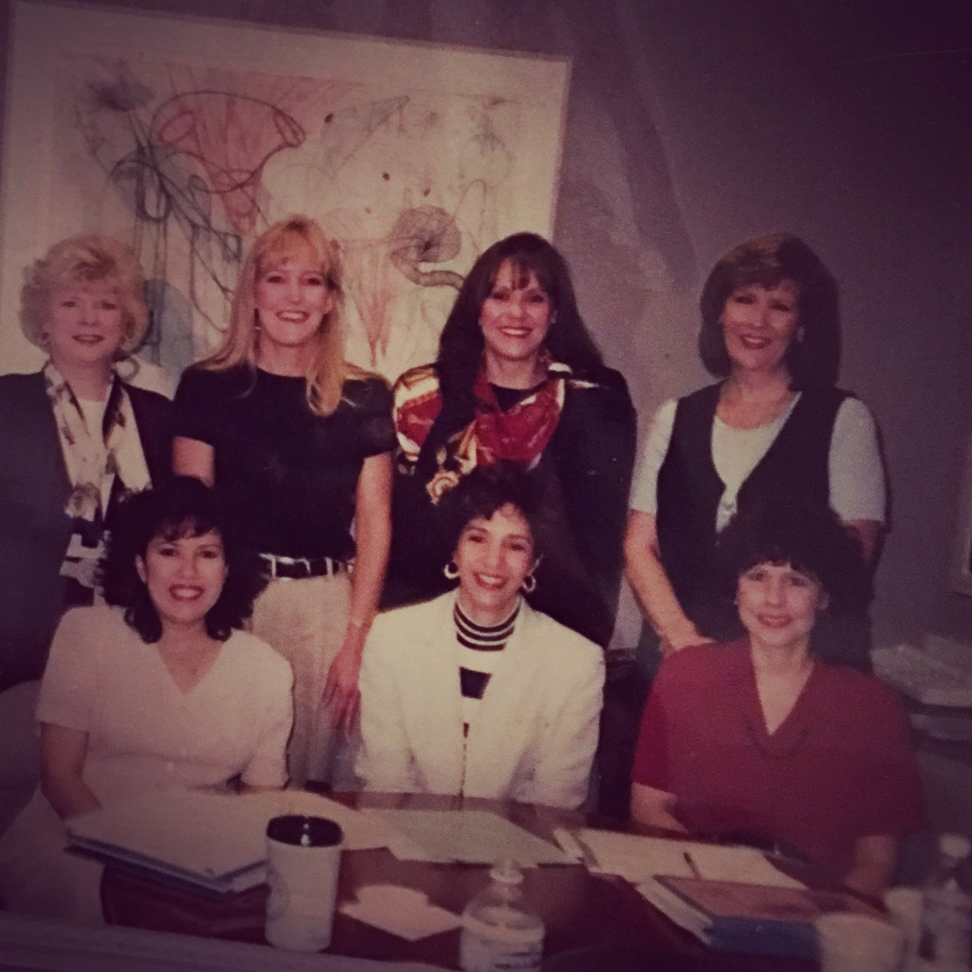 Sarah's mother Rebecca (front center), leading a team meeting