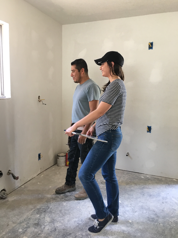 Checking in with her crew at a renovation project