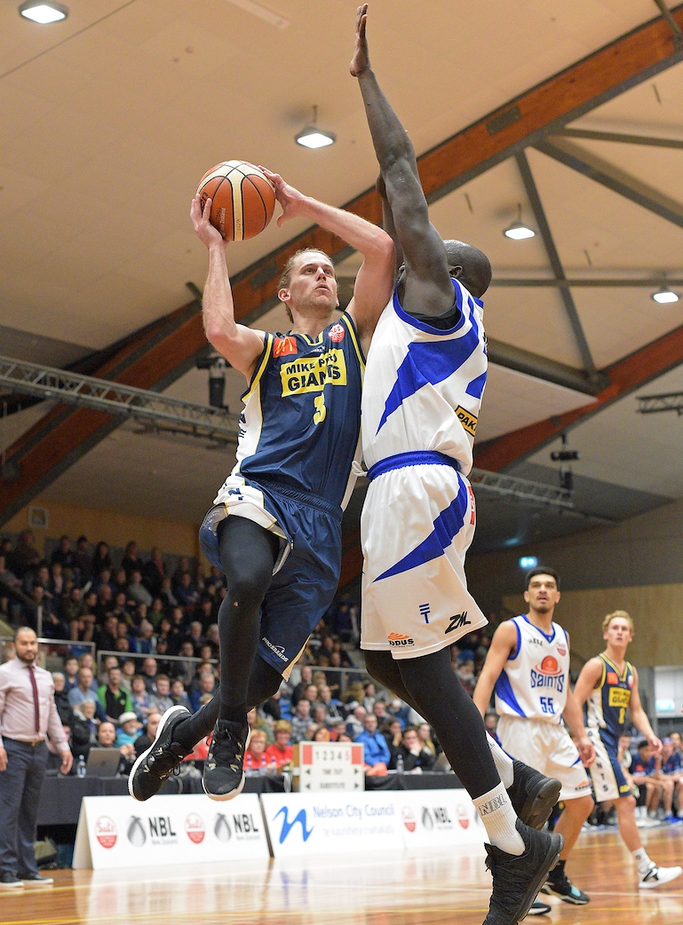 Damon Heuir takes it to the hoop .... again ... 30 points top scorer