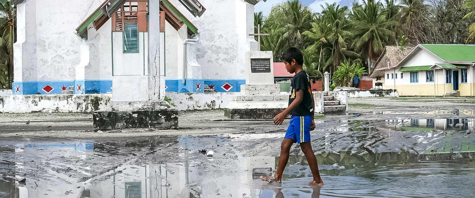 Main square of Nui Island under water. Tropical Cyclone Pam caused widespread damage and marine flooding. Photo: Silke von Brockhausen/UNDP