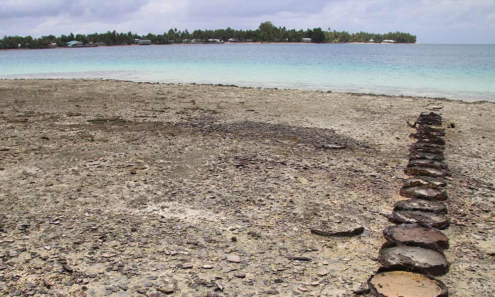Drums filled with sand, used as boat anchorage, Nanumea Island, Tuvalu. Photo: UNDP.
