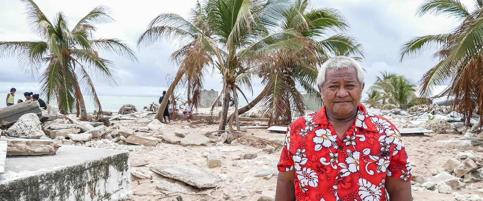 Fayvaka Keneseli Chief of Nui explains the impact of Cyclone Pam waves on his island and the greatest needs of support. Photo: Silke von Brockhausen/UNDP
