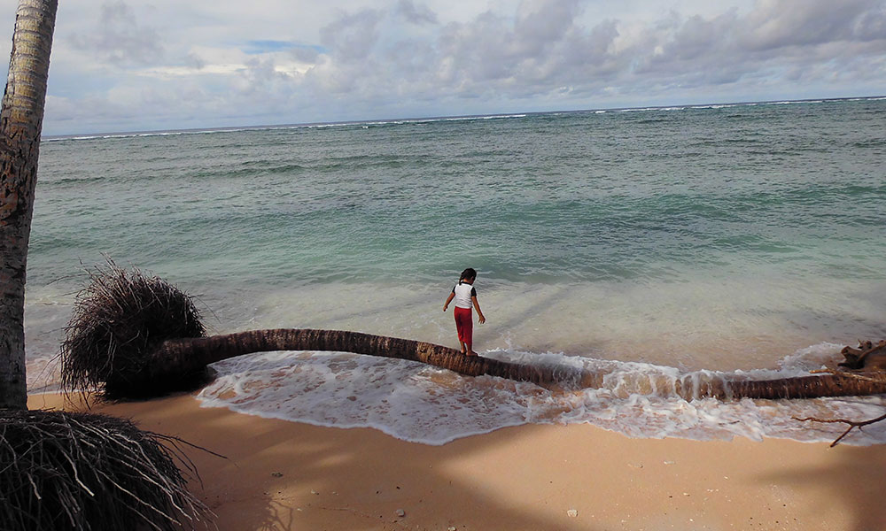 Girl playing with the waves, Tuvalu. Photo: UNDP Pacific Office in Fiji