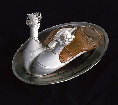 "Meret Oppenheim ""My Nurse"" (1936) / scissors  In January 1985, this Surrealist object, comprising two women's shoes arranged and tied to look like a cooked chicken, was delivered for an upcoming exhibition. Mistaking the work's strings for packaging materials, a museum employee cut and disposed of them. The error was soon realized, and the work was restored with new string in time for the opening."